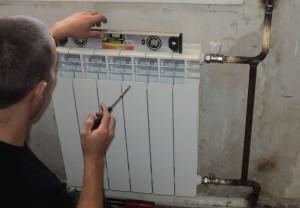 установка батареи отопления в квартире