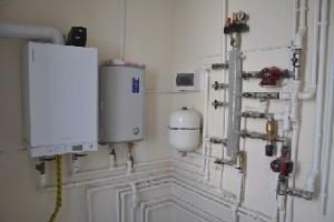 газовый и электрический котел в системе отопления